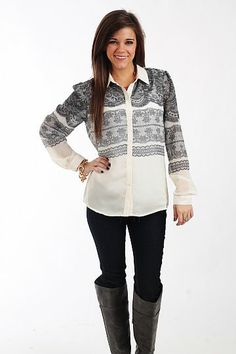"""The Victoria Blouse, Ivory $46.00  This blouse is a can't miss item! The silky material is ivory with black lace patterns printed on it for a super chic look. It has a timeless """"dress shirt"""" style but can easily be worn casually with jeans or dressed up with a skirt or slacks.   Fits true to size. Miranda is wearing a small.   From shoulder to hem:  Small - 25.5""""  Medium - 26.5""""  Large - 27.5"""""""