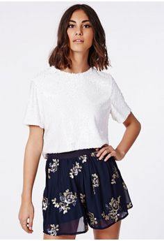 Shake and shimmer on your next night out in this sequin embellished pair of chiffon shorts. Fully lined with a ruched waist and a concealed side zip, these navy flowing beauts are perfect for the dancefloor. Style yours with a cream shirt a...