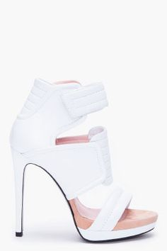 Barbara Bui white biker high heeled leather sandals. Ribbed padding throughout with foldover velcro strap closure and silver tone hardware.