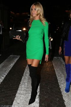 Heidi Klum shows off svelte frame in mini dress and thigh-high boots #dailymail