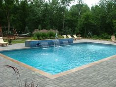 Grand Rapids Swimming Pool and Outdoor Kitchen - Signature Outdoor Concepts