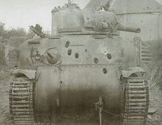 An M4 sherman early version with multiple penetrations in the front shield.
