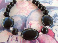 Onyx and Swarovski Crystal Bracelet by ItsMyMonkeyBusiness, https://www.etsy.com/listing/107549655/black-onyx-stones-and-swarovski-crystal
