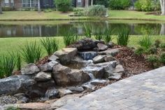 Like:Back and forth direction of the water Dislike: Plants look like soldiers lined up! Dislike: Path bricks don't go with waterfall rock