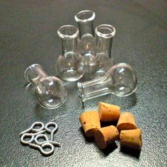 5 Tiny Glass Potion bottle Vials with cork and loop. Miniature, Tiny, Potion, Vial. DIY Pendant.. $5.00, via Etsy.