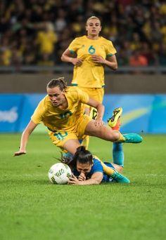 Australia's Emily Van Egmond (L) and Brazil's Beatriz fall during their Rio 2016…