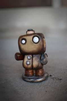 All robots wish they were this cute... Here's a little guy called I've Gone Wireless by tinyrobotfactory on Etsy.