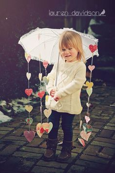 Love the idea of the hearts hanging from the umbrella.... to use as a mobile over the crib in the nursery