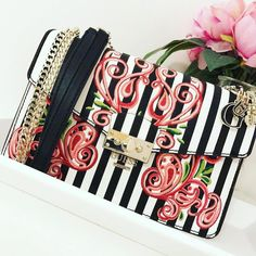 a77e34af00 Exclusively on GUESS.EU The Arianna Stripe + Flower Crossbody (    pasteldreamsbyamy)