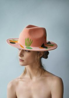 Inspired by the colors of bright Mexican doorways andHenri Matisse, Britishmilliner Laura Apsit Livens has designed a most playful and colorful collection of cloches, berets, trilbys and boatersfor fall - and quite honestly, it's herbest collection yet. TheLondon College of Fashion alumna