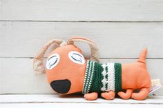 Orange linen designed dog.Abstract dog wearing green white crochet sweater.Home decor idea.Designed toy for room decoration.