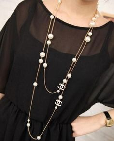 Chanel Inspired White Logo Long Necklace. $10.00, via Etsy.