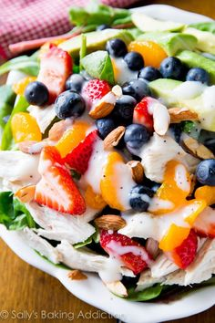 This salad has it all! Healthy, easy, and full of fresh berries, chicken, avocado and topped with creamy homemade poppy seed dressing.