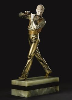 """Johann Philipp Ferdinand Preiss """"FLUTE PLAYER""""  base incised F. Preiss and impressed with foundry mark  cold-painted bronze and carved ivory on an onyx base 17 1/2 in. (44.5 cm) high circa 1925"""