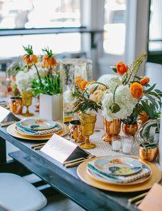 orange centerpieces + colored goblets