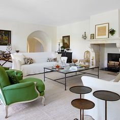 Green armchairs from Lee Wright Antiques add colour to the sitting room of a stone beauty in Luberon. Living room ideas