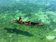 One of the most amazing captures I've done at Mabul Island Sabah Borneo.  The Sea Bajau people of Semporna are truly an amazing tribe to photograph. At Mabul Island they come around from time to time adults selling freshly caught fish and children playing around on their hand made sampans or boats.  The waters here are incredibly clear and at around 5 meters you can see how clear it is on a good day. Mabul Island is located on the east coast of Sabah and very near the world famous Sipadan…