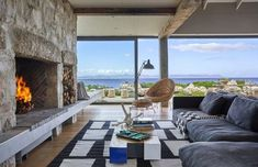 Light a fire / Contemporary coastal living at Stone House, Hermanus / South Africa. Image via Perfect Hideaways. African Interior, Holiday Accommodation, Stone Houses, Industrial Interiors, Rental Property, Coastal Living, Interior Design Inspiration, Interior Styling, Patio