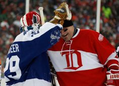 Detroit's Darren McCarty shares a moment with Toronto goalie Mike Palmateer after Palmateer made a save on McCarty.