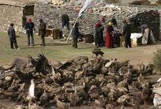 Sky burial is a ritual funeral in Tibet. The corpse is wrapped in white cloth and is placed in a corner of the house for three or five days.Monk's chant so the dead soul can be released from purgatory.The body is then taken to a burial site in the mountains.The body is ritually sliced open and vultures are the allowed to feed on the body.The remains are then cremated, with the dust spread on the wind.The soul completes its journey to Nirvana at this point.Used by the commoners in Tibet.