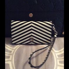 HP Lodis Patent Leather Wristlet iPhone 6 Beautiful piece.  Snap closure. Silver hardware.  Phone pocket.  ID slot.  3 card slots.  1 pocket.  Back zip coin pouch.  Measures: 5.75x3.5. Lodis Bags Clutches & Wristlets