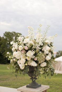 Elegant floral arrangement: http://www.stylemepretty.com/new-york-weddings/2014/04/28/elegant-backyard-waterfront-wedding/   Photography: Raquel Reis - http://www.raquelreis.com/