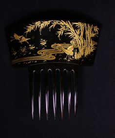 Carved in a beautiful cherry. Cranes and bamboo are painted in gold. From the collection of The Creative Museum.
