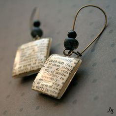 PRensa. Polymer clay, dictionary paper, resin. I want to try this...