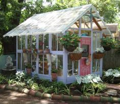10  Greenhouses Made From Old Windows and Doors -> Old window greenhouse
