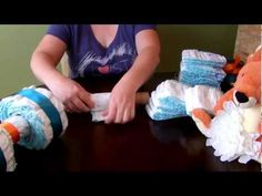 My version of a four-wheeler diaper cake. This great baby shower centerpiece or gift will have all the guests talking about it! Made with 50 diapers, a bib, a recieving blanket, a basket and a few other items, it is actually pretty easy to assemble.   Free Music from: Music4YourVids.co.uk    ♥ Closeout prices and $2 shipping on everything from elec...