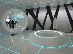 Here's a site with more pictures of the DuPont Corian Exhibition inspired by Tron Legacy. I would totally live in that.
