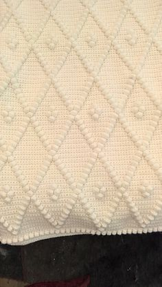 This is a single crochet afghan with bobbles that is worked in one piece. The…