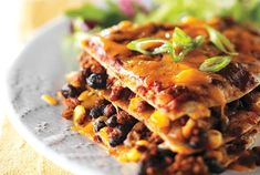 Beef and Black Bean Enchilada Bake Black Bean Enchiladas, Beef Enchiladas, Canadian Living Recipes, Enchilada Bake, Tasty, Yummy Food, Venison, Lunches And Dinners