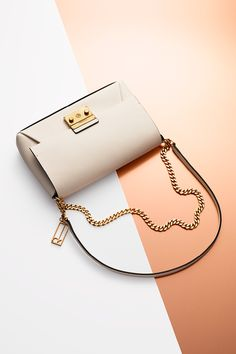 Chain attraction. Find perfect handbags for her, featuring the Galey saffiano leather clutch from Calvin Klein.
