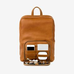 In April, Traveler obsession This Is Ground released its first ever backpack. And if you're headed out for a quick weekend trip or packed so much you've checked your main luggage, this bag really is the perfect addition: The classic leather exterior includes a hidden, removable Tile GPS tracking device, and an optional Karma Wifi hotspot, so you'll never miss an email or text on the go. Plus, the back section has pockets for your devices that, when unzipped, lays flat and acts as its own…