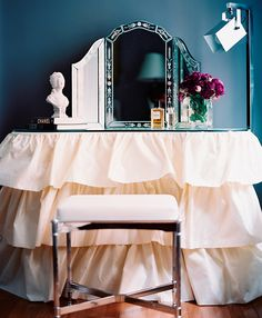 A tiered skirt dresses up a kidney-shaped table for an ultra-feminine vanity. - Traditional Home ® / Photo: Patrick Cline / Design: Ryan Korban