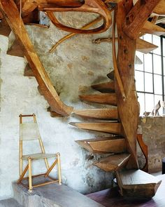 Wood stairs. We love how the two stairs connect.