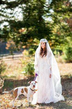 Wedding dog photos | this gorgeous bride strikes a pose with her rescue dog who is wearing a flower collar for this Fall wedding!
