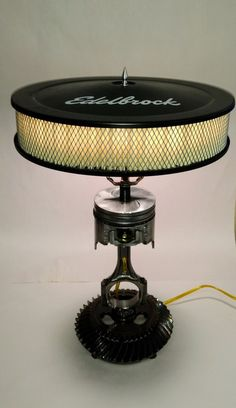 This lamp is by far the coolest gift anyone can give or receive This lamp is custom made from an automotive piston, rod, and gears The shade is a well known Edelbrock Air Filter Fully functional lamp It measures 20 inches tall, 8 inches at base, - d
