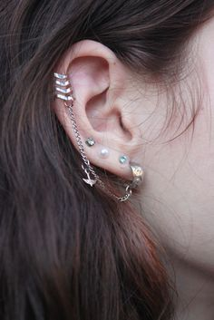 """Ear #piercings [via Kailey Lamey] ~ Creative! especially the 4 at the bottom; the chain could be switched out even if the top is a """"cuff."""""""