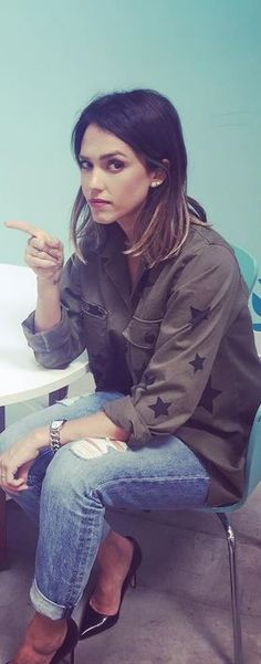 Who made Jessica Alba's green star jacket?