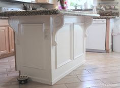 """Add wall, board and corbels to give an island a """"furniture"""" look.  lollyjaneboutique.com"""