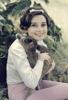 Audrey Hepburn and her pet fawn Pippin.  Photograph by Bob Willoughby, 1958.