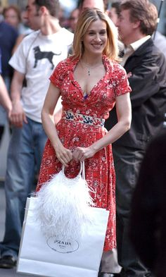 Carrie Bradshaw Carrying A Prada Shopping Bag And Wearing A Low-Cut Red Floral Dress, Season 6