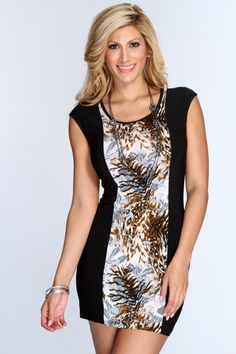 This trendy little dress will have you walking out with confidence! This look will definitely take your wardrobe to a whole new level! Make a statement with this eye catching dress! It features animal printed design, scoop neck, short sleeves, and tight fitted. 95% Polyester 5% Spandex. Made in USA.