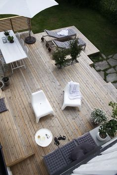 Wood deck / terrace at the beautiful monochrome Norwegian home of Elisabeth Heier in summer time. Wood deck / terrace at the beautiful monochrome Norwegian home of Elisabeth Heier in summer time.