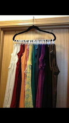 Use a hanger with Shower curtain rings to organize your tank tops.....y didn't I think of this!?