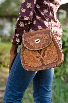 Vintage Tooled Leather Shoulder Bag. $50.00, via Etsy.