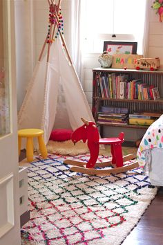 Colourful Azilal Handwoven wool rug from #tigmitrading perfect for kids bedroom