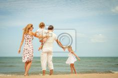 Stock photo of Happy family standing at the beach in the day time 55498167 - image 55498167